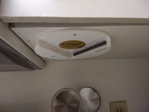 Jar opener installed under kitchen cabinet