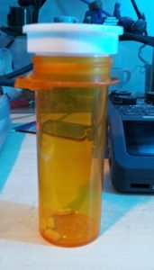 Prescription pill bottle with lid upside down