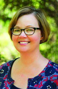 Dr. Karen Sullivan headshot in front of trees