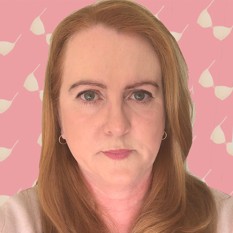 Rachel Whittaker faces the camera in front of a pink background with a repeating pattern of Bras.