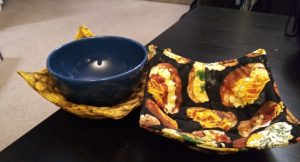 2 bowl cozies side by side. The left one has a blue bowl